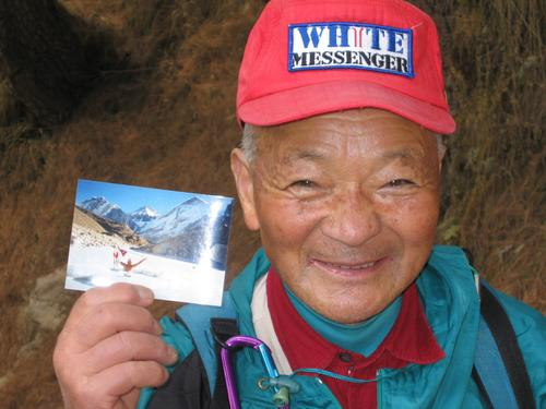 80 year old Osawa with photo of himself swimming in icy waters of 18,000 foot lake.