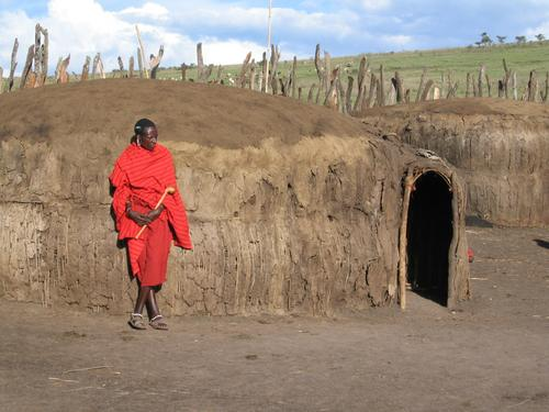"Maasai next to his ""boma"" (made of mud and dung)"